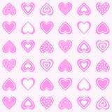 无缝抽象的模式 五颜六色的印刷品组成由在光玫瑰色背景的桃红色装饰心脏 免版税库存照片