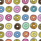 无缝油炸圈饼美好的样式 免版税库存图片