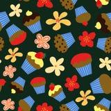 无缝的传染媒介样式用五颜六色的杯形蛋糕和花在黑暗的背景 皇族释放例证
