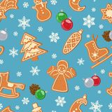 无缝的冬天样式用与釉和雪花的姜饼 向量 免版税库存照片