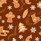 无缝的冬天样式用姜饼和雪花 也corel凹道例证向量 免版税库存图片
