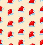 无缝的圣诞节样式圣诞老人红色帽子 免版税库存图片