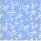 无缝的在蓝色的样式白色雪花 免版税图库摄影