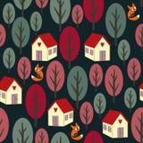 无缝的夜秋天样式-五颜六色的树、房子、雪和狐狸 库存照片