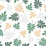 无缝的明亮的图解地风格化绿色和黄色自然叶子仿造在白色背景的纹理元素 图库摄影