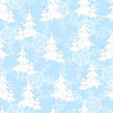无缝的样式、白色新年树和雪花 免版税库存照片
