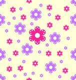 无缝的样式桃红色和紫色花形状 免版税库存照片