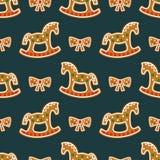 无缝的样式用圣诞节姜饼曲奇饼-摇马和弓 库存照片