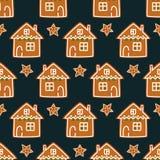 无缝的样式用圣诞节姜饼曲奇饼- xmas星和逗人喜爱的房子 免版税库存照片
