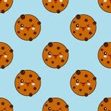 无缝的样式用在蓝色背景隔绝的巧克力曲奇饼 库存图片