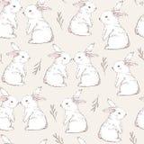 无缝的样式用逗人喜爱的白色兔子 拉长的现有量向量 免版税库存照片