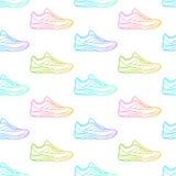 无缝的样式由运动鞋制成 库存图片