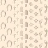 无缝的样式脚印背景 免版税库存图片