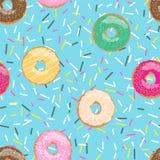 无缝的样式蓝色明亮的鲜美传染媒介油炸圈饼和在咖啡馆和商店洒在动画片样式的背景菜单的 向量例证