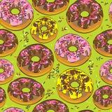 无缝的样式给上釉的油炸圈饼  库存图片