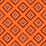 无缝的样式-橙色rombs 免版税库存照片