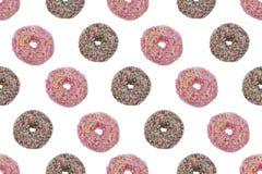 无缝的样式ofPink和巧克力给上釉的油炸圈饼 免版税库存照片
