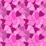 无缝的桃红色心脏样式 库存照片