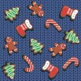 无缝的模式 圣诞节在被编织的背景的姜饼曲奇饼 羊毛毯子 圣诞节款待 欢乐 皇族释放例证
