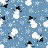 无缝的模式 在一个蓝色背景的雪人 库存图片