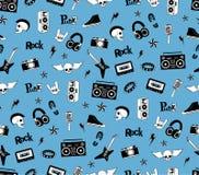 无缝的模式 在蓝色背景的庞克摇滚乐音乐 乱画样式元素、象征、徽章、商标和象 免版税库存照片