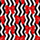 无缝的模式 在黑白背景的红色弓 图库摄影