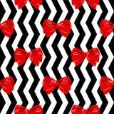 无缝的模式 在黑白背景的红色弓 免版税库存图片