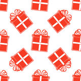 无缝的礼物样式,在白色背景的红色礼物盒 图库摄影