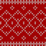 无缝的红色和白色被编织的背景 库存图片