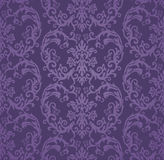 无缝的豪华紫色花卉锦缎墙纸 库存图片