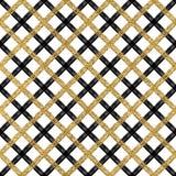 无缝的黑和金黄发光的方格的背景 免版税库存照片