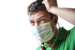 无能为力,急切和出汗的医生 免版税库存图片