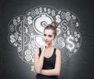 无袖衫的沉思妇女和美元的符号覆盖 免版税库存照片