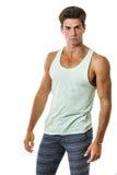 无袖衫的英俊的在白色背景的人和绑腿 时髦的头发 免版税库存照片