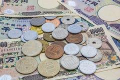 日元钞票和日元硬币 免版税图库摄影
