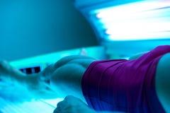 日光浴室的年轻人美容院的 库存图片