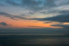 日出在一多云天 库存图片