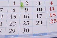 日历和浅绿色的夹子 库存图片