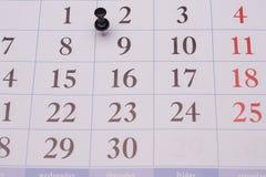 日历和黑夹子 免版税库存照片