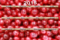 日历在樱桃背景的2015年 免版税库存图片