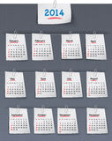 日历在稠粘的笔记的2014年附有亚麻布bac 免版税库存图片