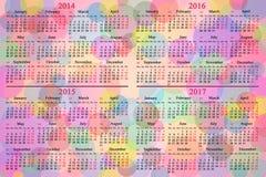 日历在色的背景的2014年- 2017年 库存照片