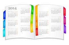 日历在2014年在开放书 免版税库存照片