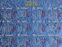 日历在2016年在蓝色背景 库存照片