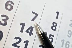 日历页和笔 免版税库存照片