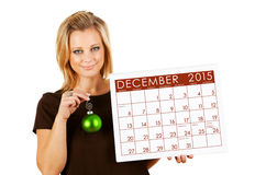 2015日历:拿着12月圣诞节装饰品 库存图片