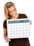 2015日历:拿着1月日历 库存图片