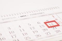 2015年日历 与红旗的2月日历在14 Februa 免版税库存照片