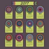 日历2017年 葡萄酒装饰五颜六色的元素 装饰花卉东方样式,例证 库存照片