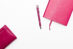 日志、笔和钱包在白色背景 库存图片